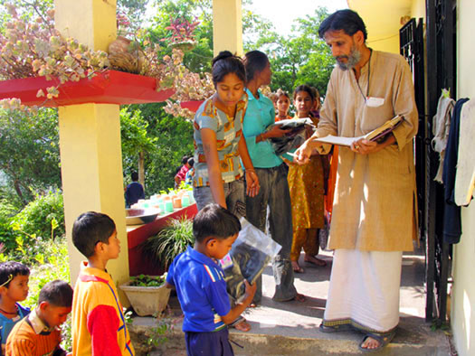 Each child receives an article of clothing